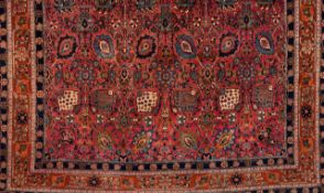 A Malayer rug, IranWool and cotton Floral pattern in red, blue and beige shades (signs of wear)<