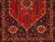 A Shiraz rug, IranWool and cotton of geometric pattern in bordeaux and beige shades305x2