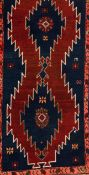 A Kazak rug, RussiaWool and cotton of geometric pattern in blue, salmon and beige shades