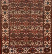 A Bakhtiari rug, IranWool and cotton of geometric and floral pattern in beige, bordeaux and blue