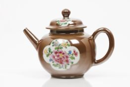 A teapot with cover