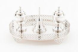 An inkwellPortuguese silver Oval stand with pierced gallery on 4 geometric motifs pierced feet