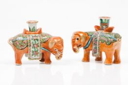 A pair of elephant candle stands