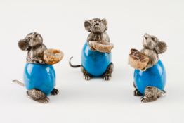 Set of three mice holding geodesSilver and blue hard stone egg Moulded and engraved sculpture wi