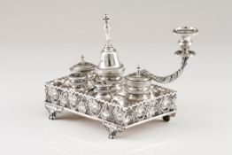 An inkwellPortuguese silver, 19th century Rectangular stand of pierced gallery with vines and gr