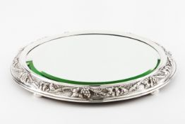 A centrepieceSilver framed mirrored stand Low relief wine related decoration on 4 flattened ball