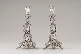 An unusual pair of candlestandsPortuguese silver, 19th century Profuse Romantic era decoration o