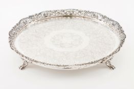 A galleried salverPortuguese silver 19th century Profuse decoration to centre with double band o