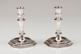 A pair of candlestandsAustrian silver Turned and faceted shaft on a stepped octagonal raised sta