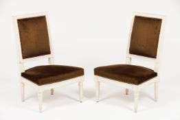A pair of Louis XVI style low chairs