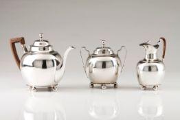 A tea setPortuguese silver Neoclassical decoration, plain body of circular lid pommel and feet O