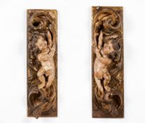 A pair of carved fragments with cherubs