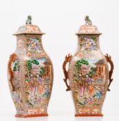 An unusual pair of vases and covers