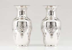A pair of vasesPortuguese silver Engraved and chiselled body and neck decoration of foliage, bo