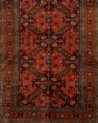 A Russian rug, CaucasusWool of geometric and floral pattern in salmon, beige and blue shades