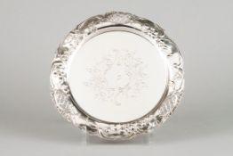 A salverPortuguese silver Central chiselled floral decoration with part pierced lip of raised fl