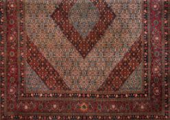 A Moud rug, IranWool and cotton of geometric and floral design in shades of salmon, beige and bl