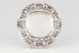 A salverPortuguese silver Plain centre of raised winglet, shell and floral decoration to lip Eag