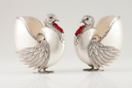 A pair of turkeysPortuguese silver and nautilus shell Moulded, chiselled and engraved silver wit