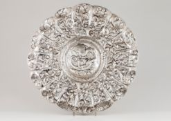 A large display salverSilver, 18th century Gadrooned of profuse repousse and chiselled foliage,