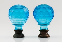 A pair of pine conesBlue cut glass Metal fittings