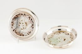 A pair of Luiz Ferreira coastersPortuguese silver Circular shaped with carved jadeite applied el