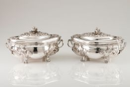 A pair of tureens and coversSilvered metal Baroque decoration, undulating elliptic body of rais