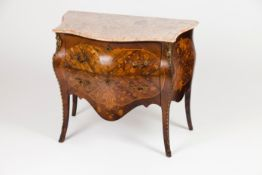 A pair of small Louis XV commodes
