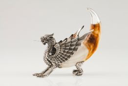 A dragonSilver and warthog tusk Moulded, engraved and chiselled silver with applied glass eyes R