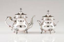 A small teapot and sugar bowlPortuguese silver Plain body on four scroll feet and volute handles