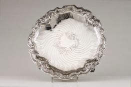 A salverPortuguese silver Engraved centre of foliage framed cartouche of spiralled lines Scallo