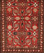 A Mahal rug, IranWool and cotton of geometric and floral pattern in bordeaux, green and beige sh