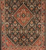 A Zarand rug, IranWool and cotton of geometric and floral pattern in salmon, blue and beige shad