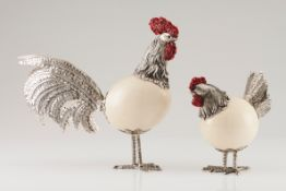 A cockerel and henMoulded, scalloped, engraved and chiselled sculpture with dyed shell combs and