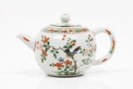 A tea pot and cover