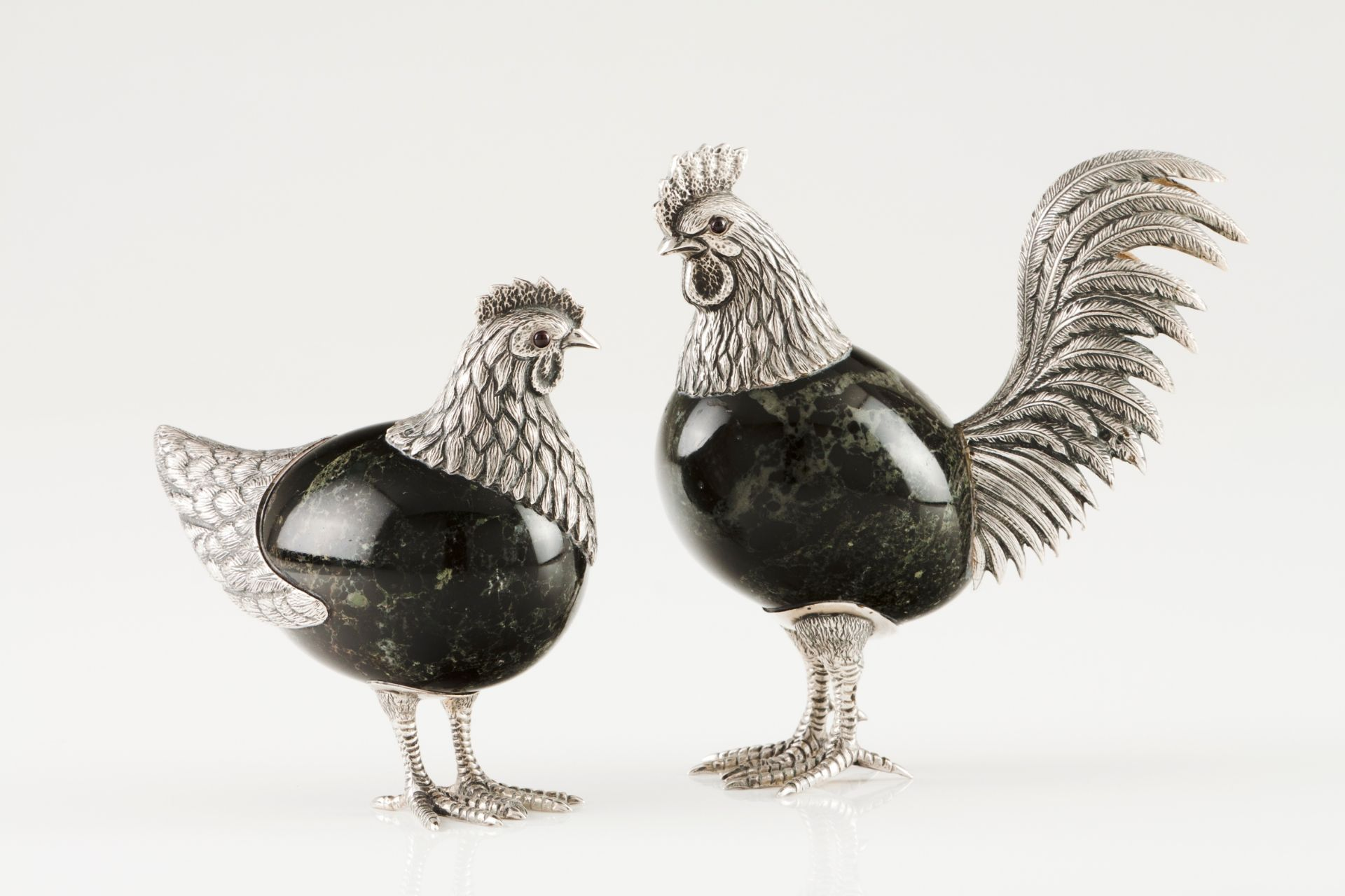 A cockerel and henSilver and hardstone Moulded, engraved and chiselled silver with applied glass