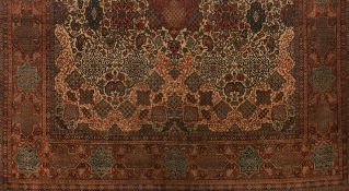 A Shahreza rug, IranWool and cotton Floral pattern of central medallion in red, blue and beige s