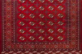 A Bukhara rug, IranWool and cotton of geometric pattern in bordeaux and beige340x265 cm