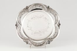 A salverPortuguese silver Floral and foliage chiselled centre of scalloped and pierced decoratio