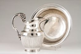 A ewer and basinPortuguese silver, 19th century Part fluted body of gadrooned lip Faceted handle