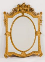 A Napoleon III mirrorCarved and gilt wood and gesso Sectioned frame of central oval bevelled