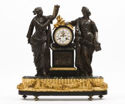 A large table clockBronze and marble Enamelled dial of Roman numbering, flanked by two figures