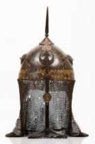 "An Indo-Persian ""Kulah-khud"" helmetIron Single metal sheet beaten cap of raised faces decoration and"
