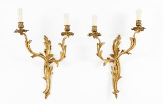A set of four Louis XV style two branch wall sconcesGilt bronze Moulded decoration 20th