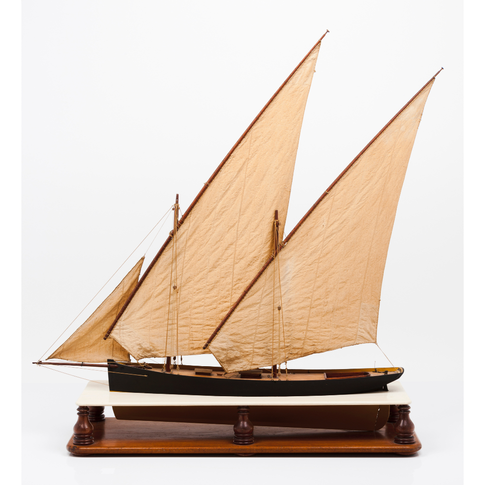 A model of the tall shipWood, textile and metal of three lateen sails Wooden display stand 20th