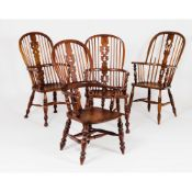 A set of four different chairs Windsor styleChestnut and other timbers Scalloped table, legs with