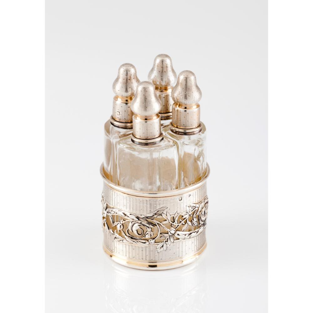 A small liqueur box setSilver Guilloche and pierced foliage decoration Four glass bottles Paris