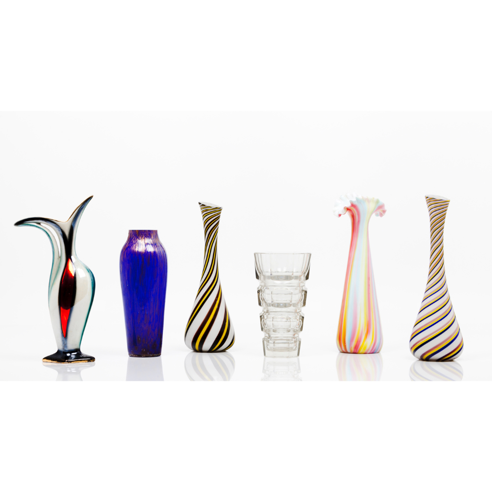 A group of six vasesGlass and glass paste of miscellaneous decorations Height: 32 cm