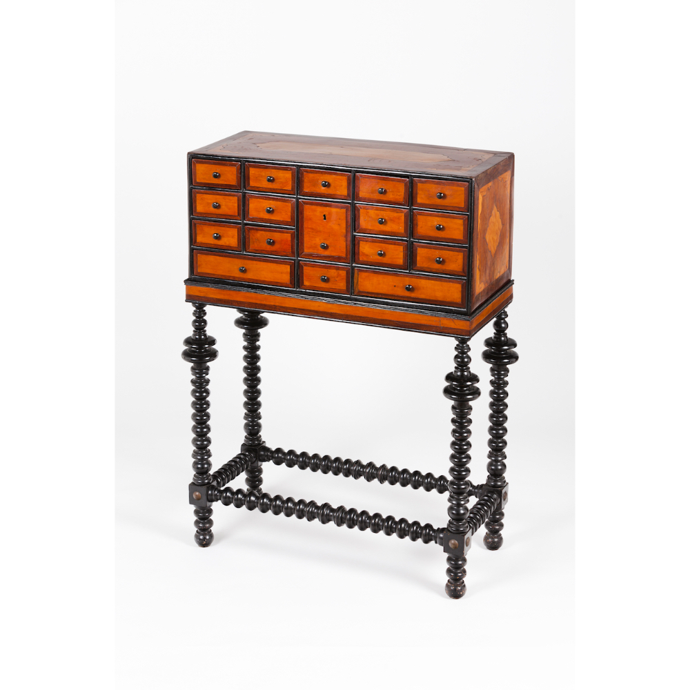 An Indo-Portuguese cabinet on standTeak and other timber Seventeen miscellaneous drawers of ebonised