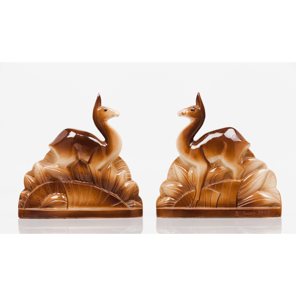"""A pair of Art Deco doesCeramic sculpture Polychrome decoration Marked """"SCT France 987/2"""" France,"""